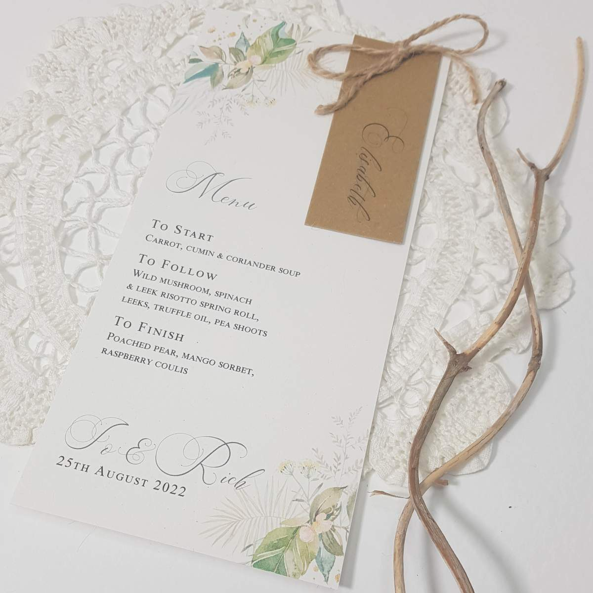 personalised wedding menu with place card attached