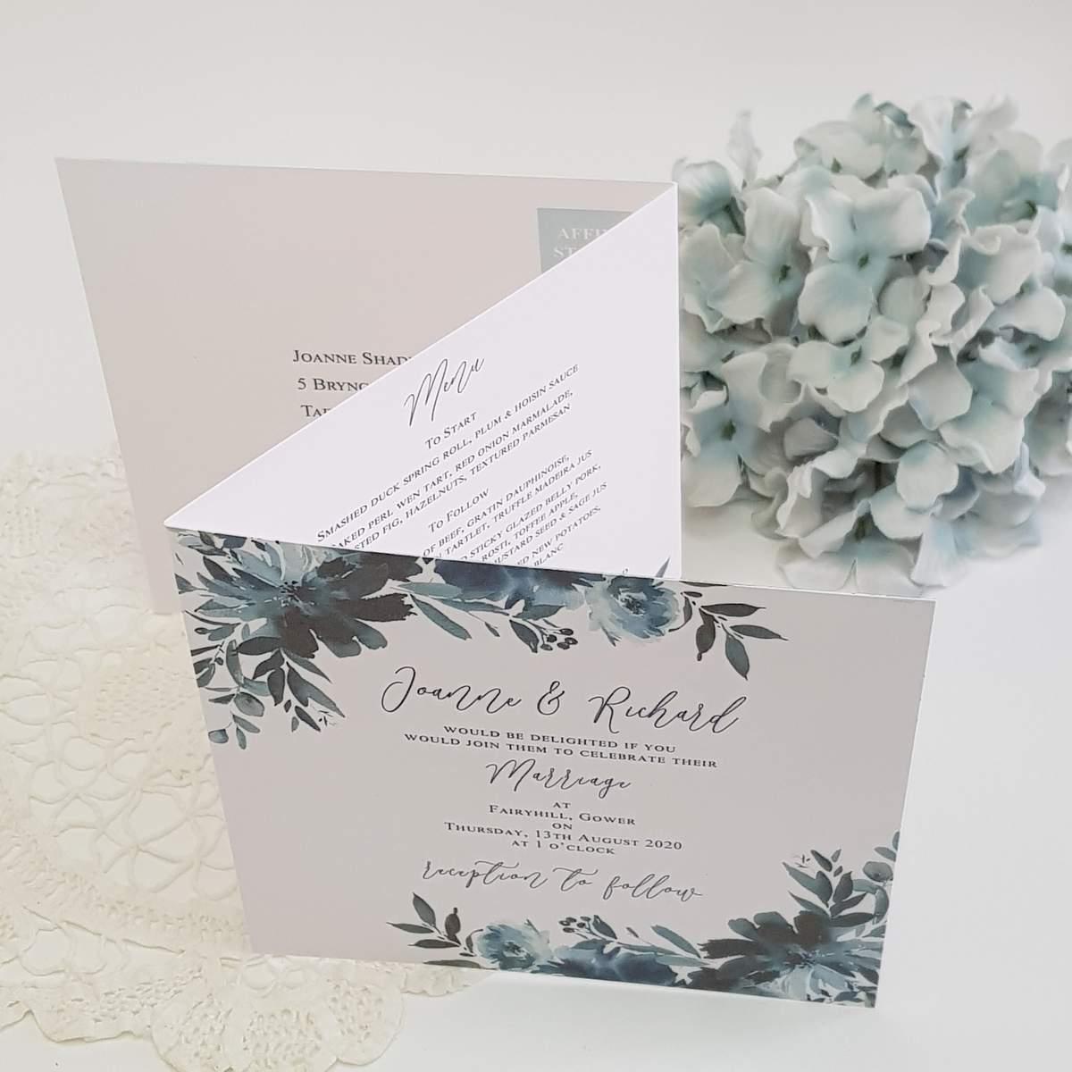 concertina wedding invitation with navy flowers
