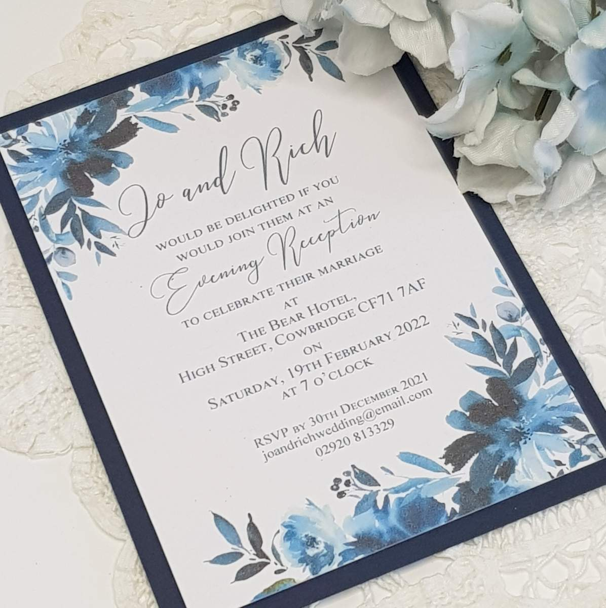 flat wedding invitation with a navy blue floral print