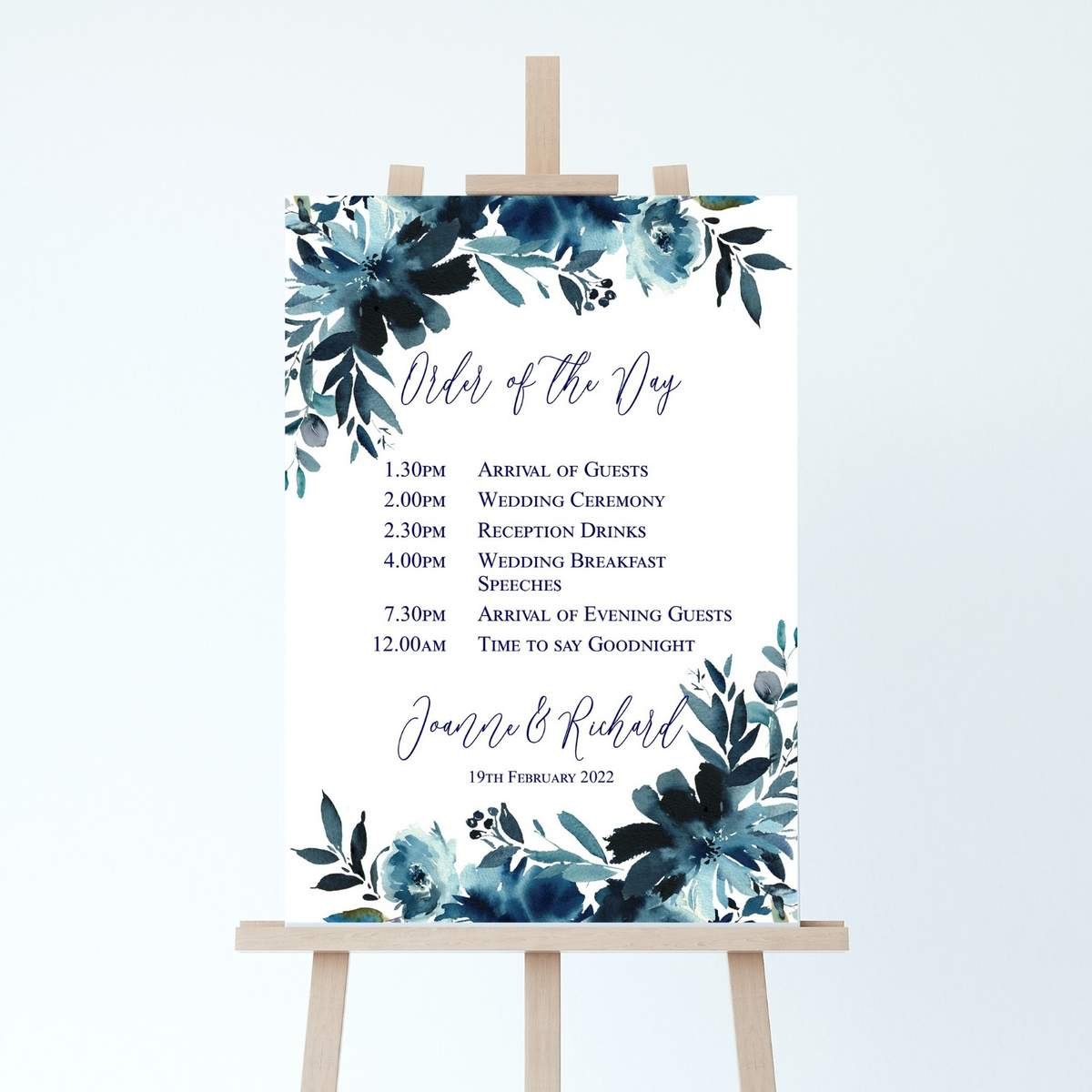 wedding order of the day board with a navy blue floral design