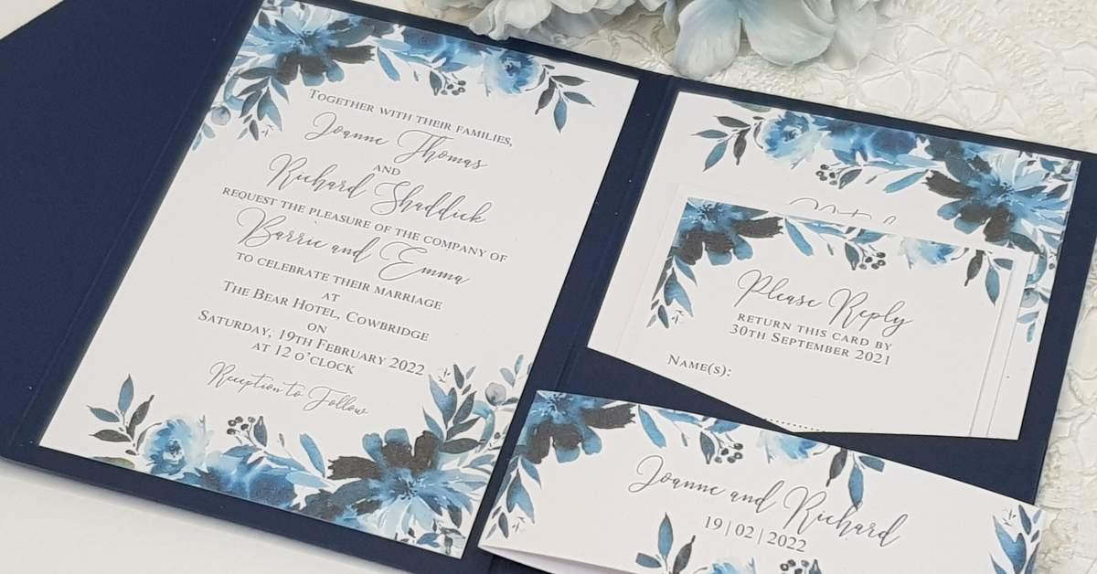 pokcetfold wedding invitation with navy floral design