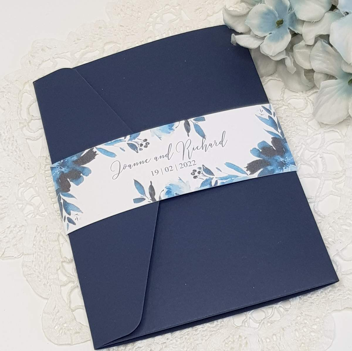 navy wedding invitation with a printed floral bellyband