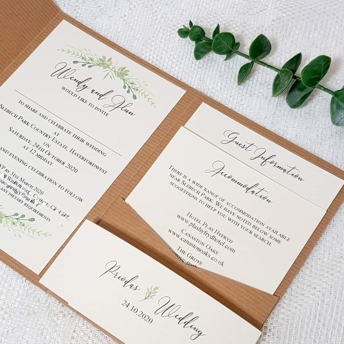 A rustic kraft card pocketgfold style wedding invitation with recycled crema card inserts and a pretty greenery design