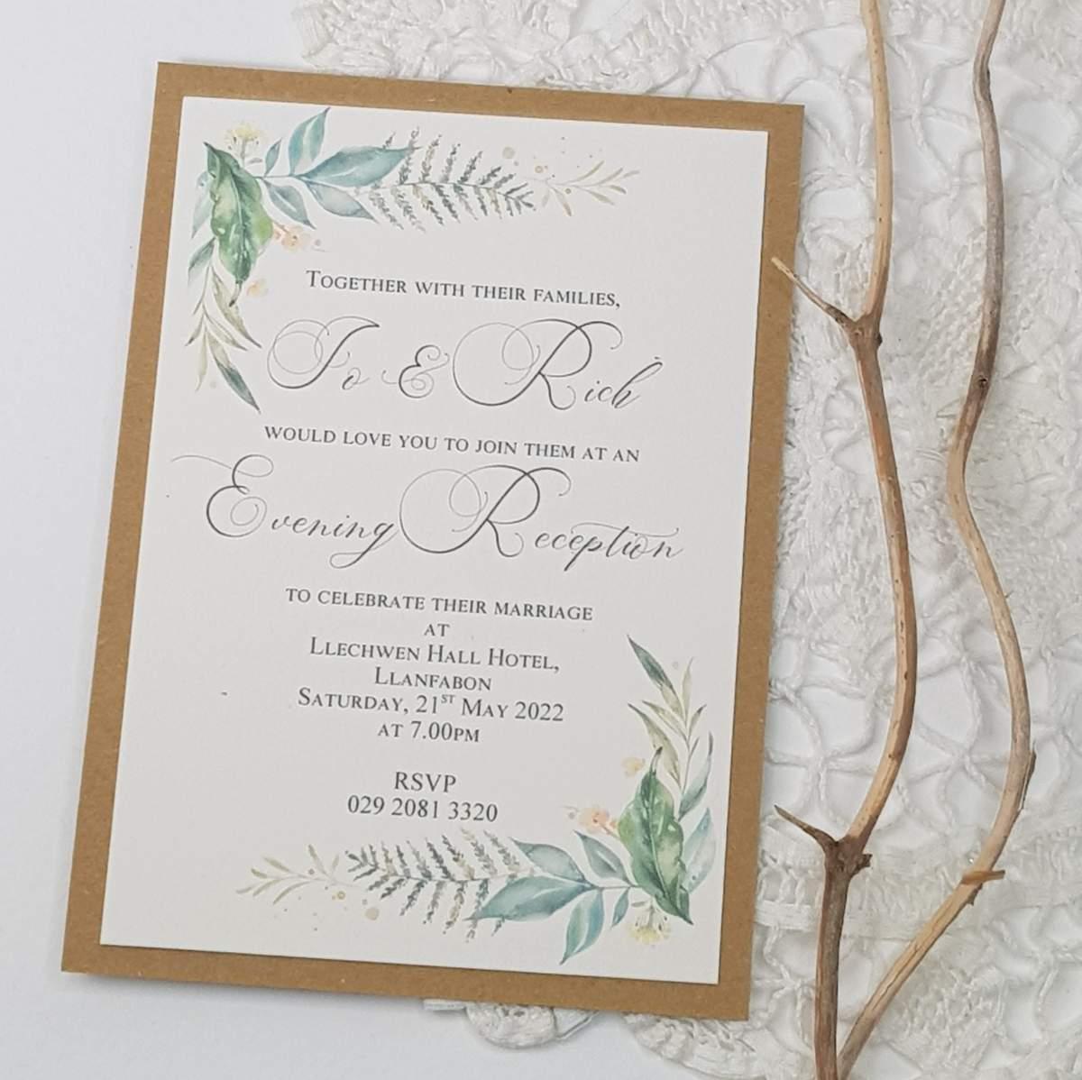 A recycled card wedding invitation with a pretty woodland fern design on each corner