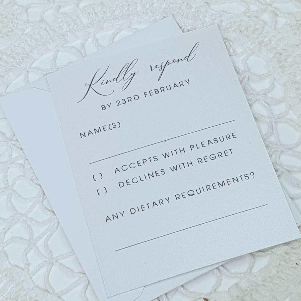 A mordern calligraphy style wedding reply card