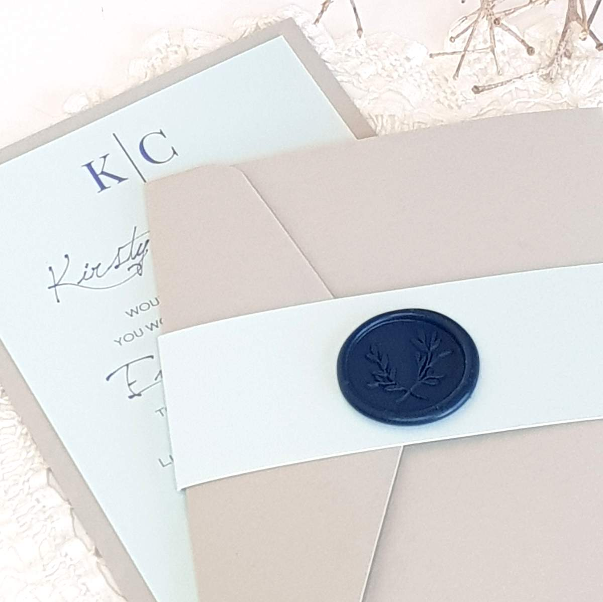 wedding invitation with bellyband and wax seal