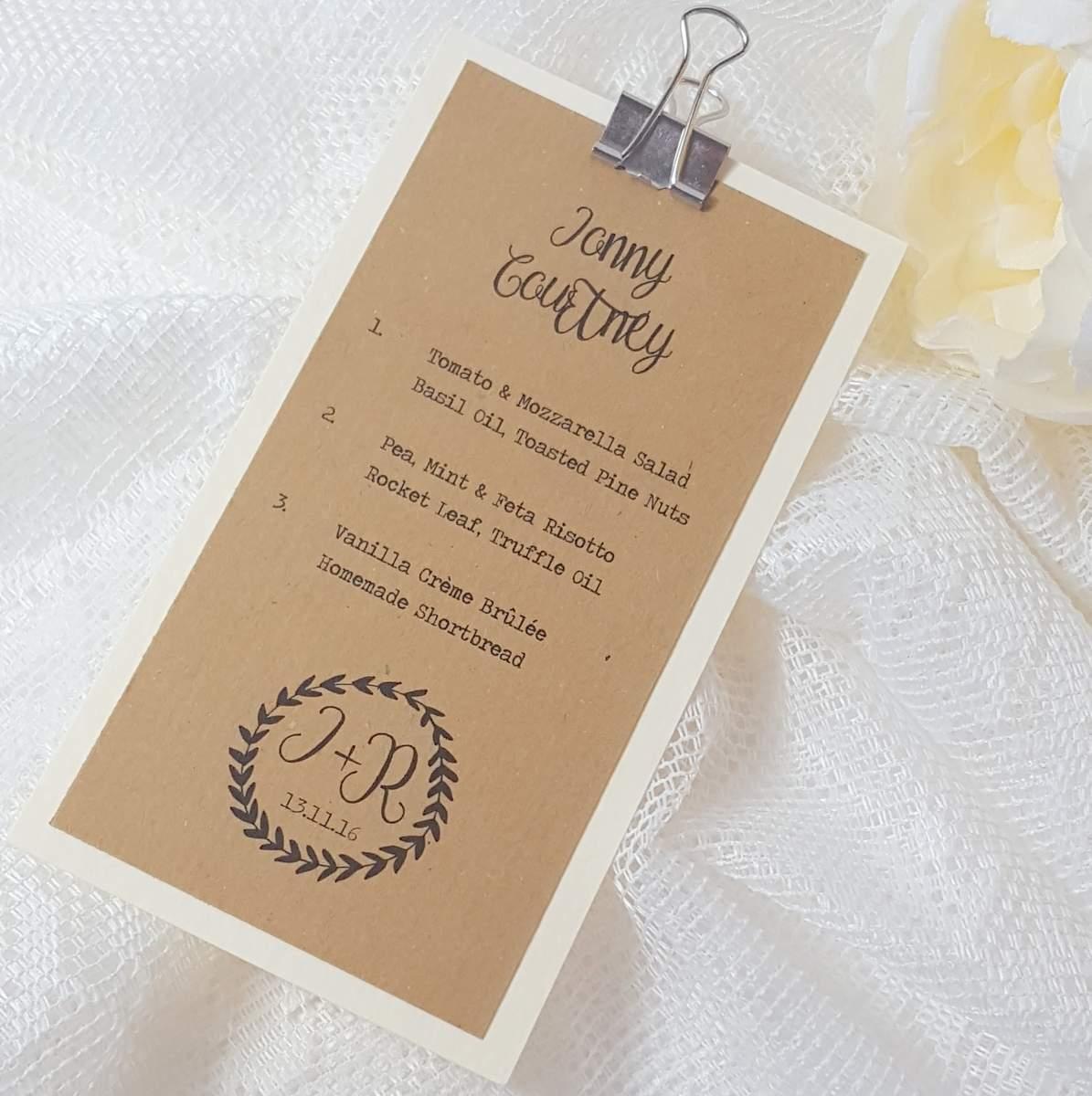 plastic free bookmark style wedding menu with metal binder clip