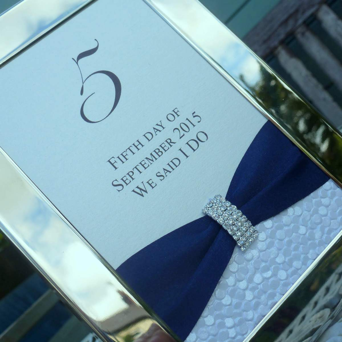 a bespoke wedding table name in an elegant silver frame