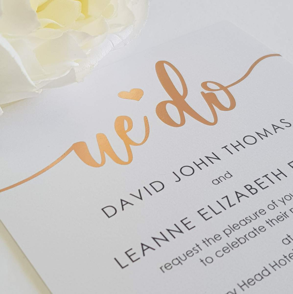 Modern printed wedding invitation black text on white card with rose gold foil accents