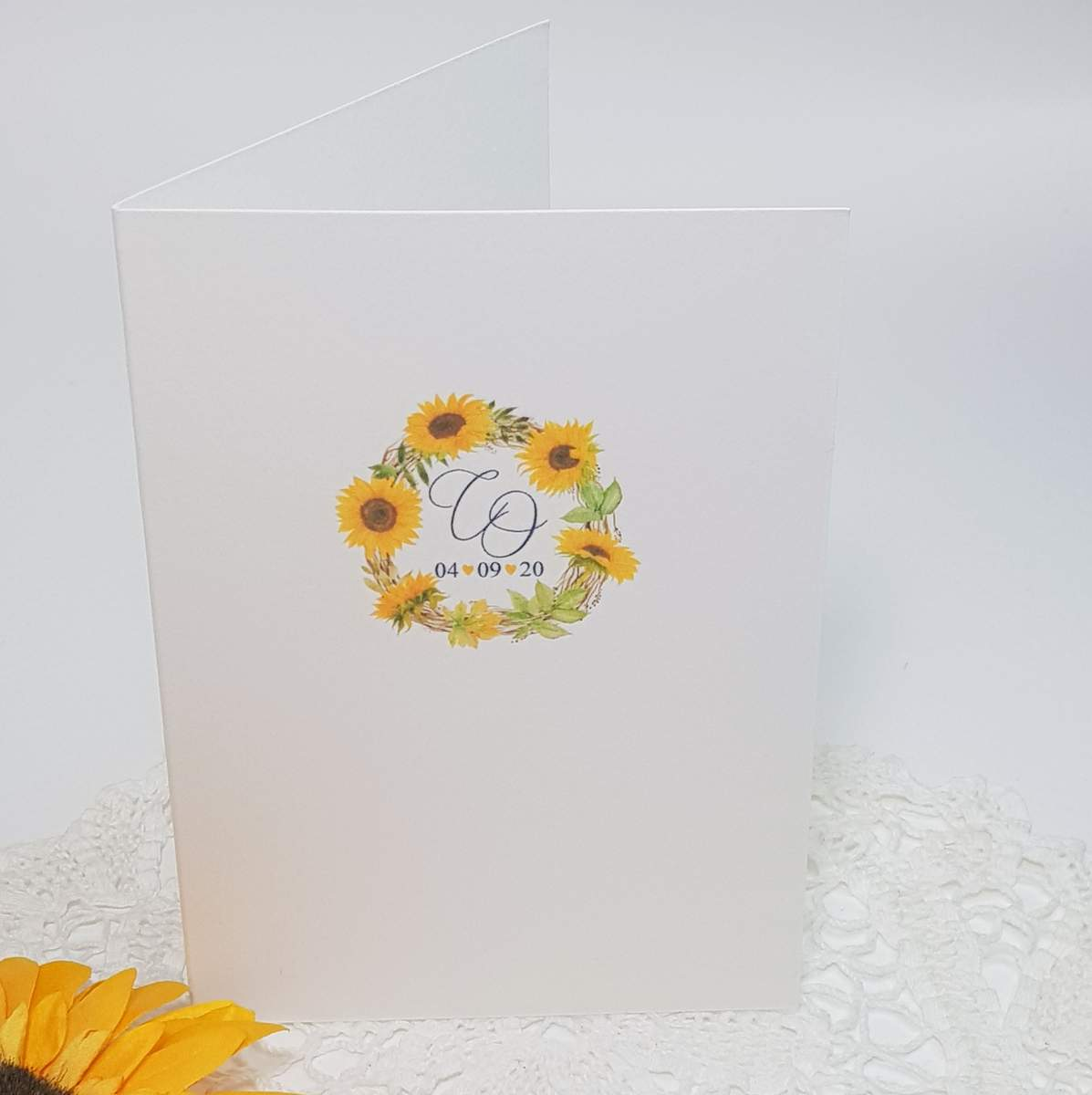 Wedding program booklet with a yellow sunflower wreath design