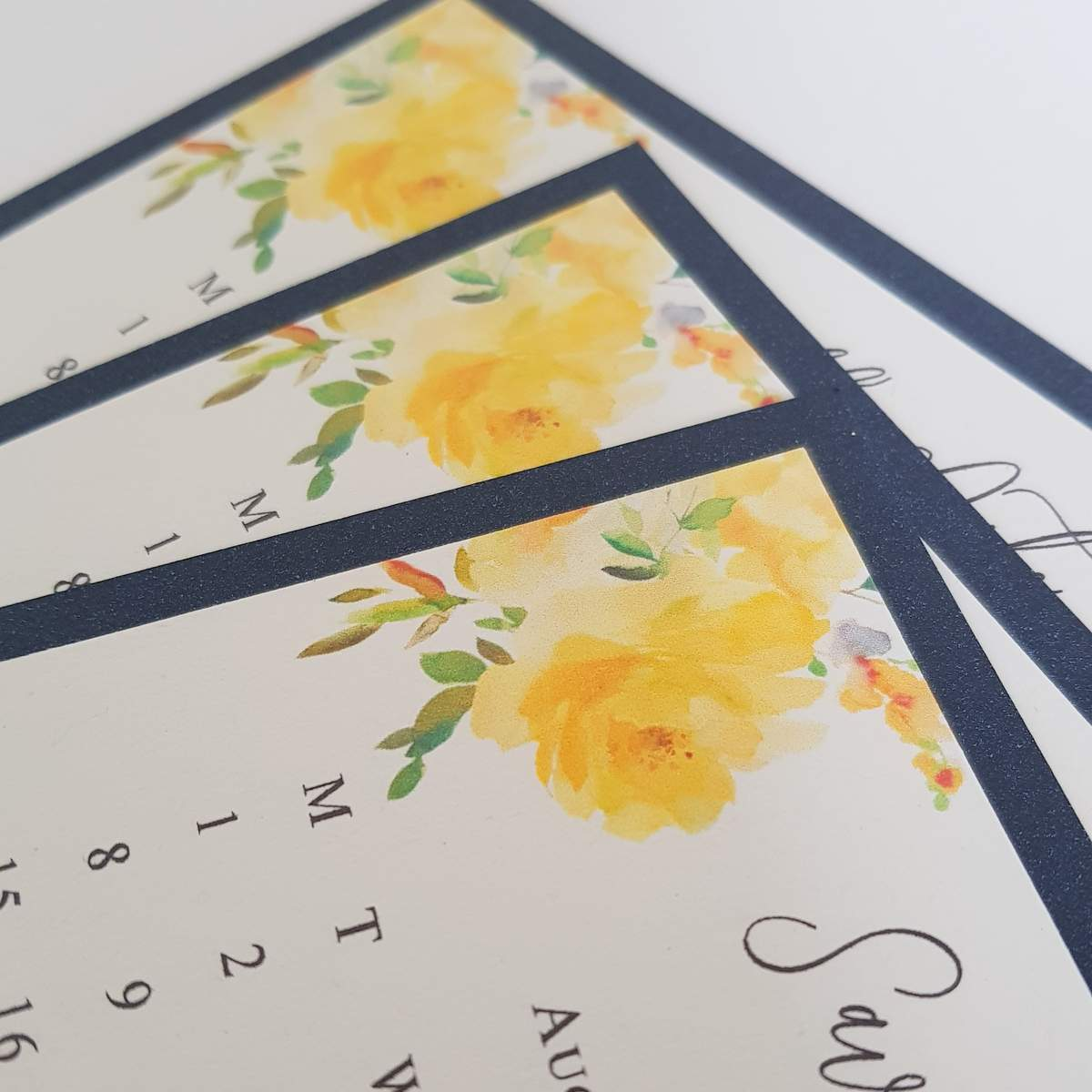 Wedding save the date cards with yellow flower and a navy blue border