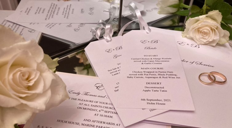 White personalised wedding menu tags