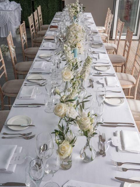 Wedding reception table with elegant white flowers