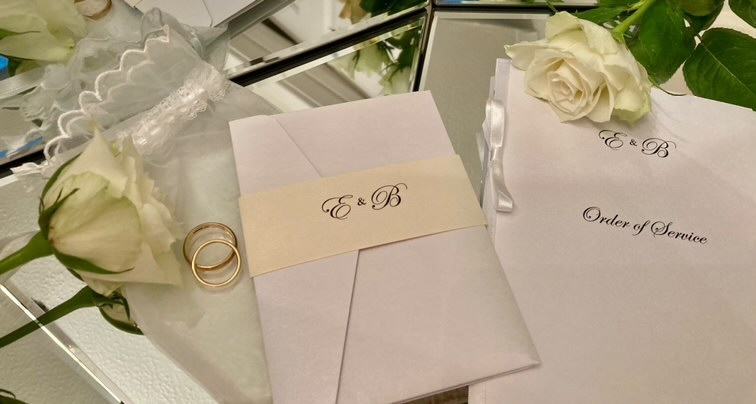 ELegant white and cream pocketefold wedding invitation with an E&B monogram